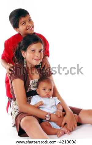 Three beautiful biracial siblings isolated on white. - stock photo