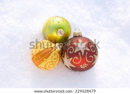 Three beautiful decorative spheres on a white snow - stock photo