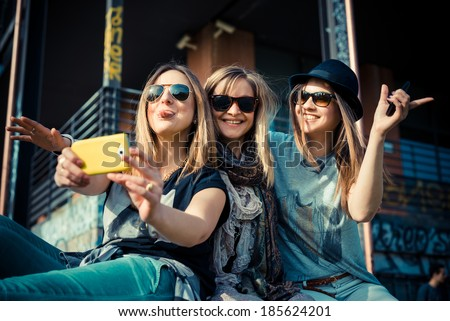 three beautiful friends authentic in urban contest - stock photo