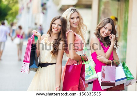 Three beautiful girlfriends with with Shopping Bags - stock photo