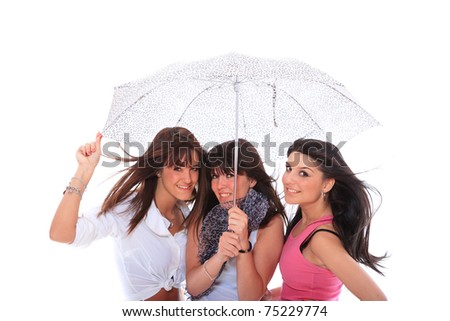 Three beautiful girls are standing under the umbrella. isolated on white background