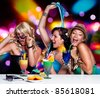 three beautiful girls celebrating in a club - stock photo