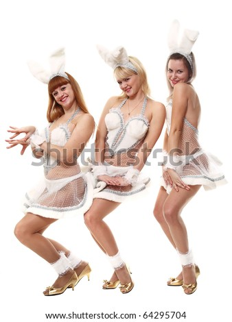 Three beautiful girls in suits of a hare on a white background