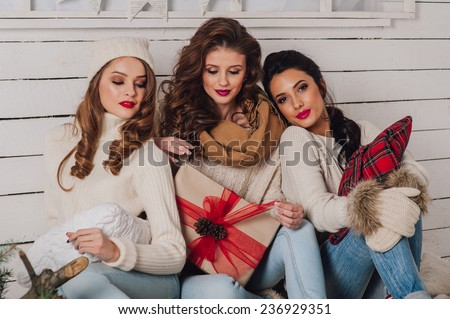 Three beautiful girls with gifts