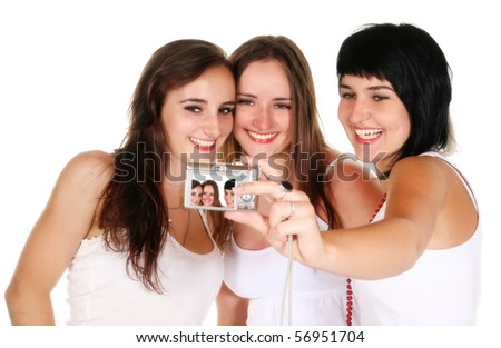 Three beautiful, happy, smiling young girls taking a picture of themselves - stock photo