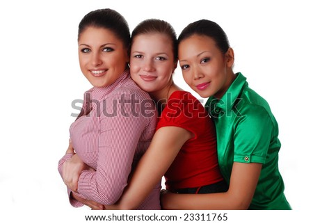three beautiful happy young friends embrace one another