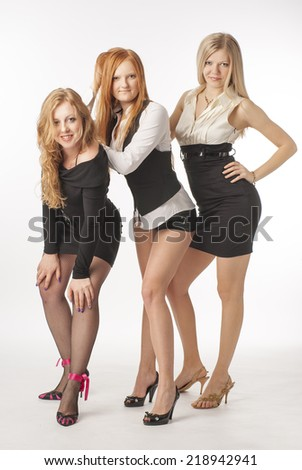 Three beautiful sexy girl on white background. Portrait of a business woman