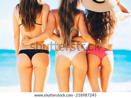 Three Beautiful Sexy Girls in Bikinis on the Beach - stock photo