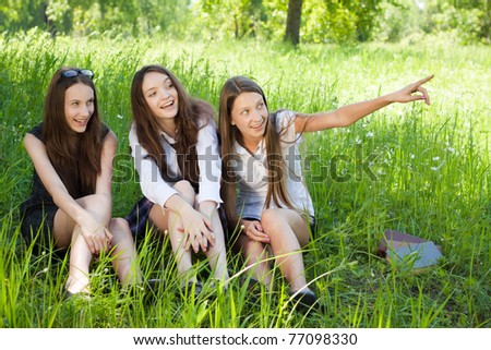 three beautiful smile student girl in the park