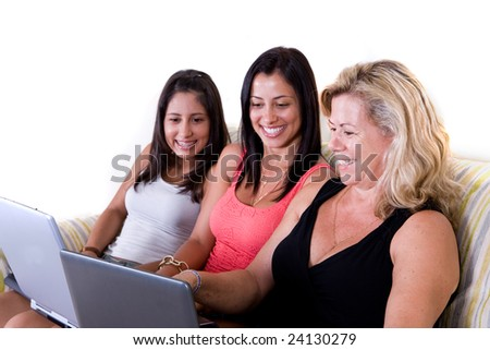 three beautiful woman of same family sitting - stock photo