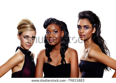 Three beautiful women of different races with different makeup and fashion hairstyles over white background. Focus on the blond - stock photo