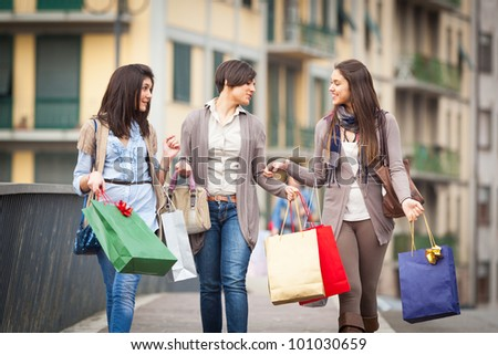 Three Beautiful Young Women with Shopping Bags - stock photo