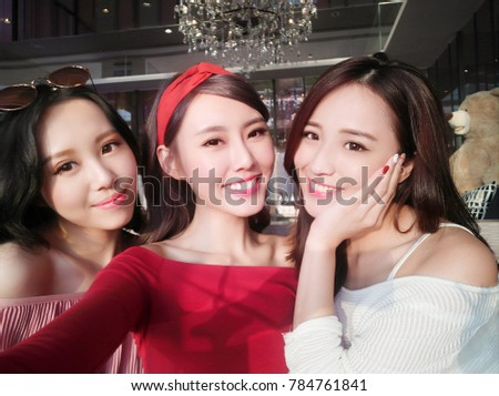 three beauty woman selfie happily in the restaurant