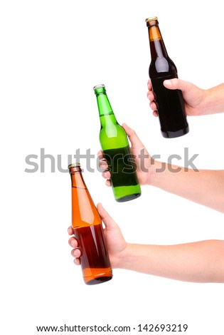 Three beer bottles and three hands isolated on white - stock photo