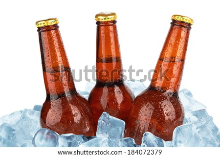 Three beer bottles in ice with condensation isolated on white background - stock photo