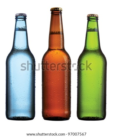 Three beer bottles on isolated background - stock photo