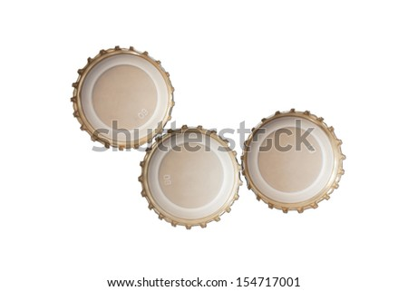 Three beer caps on white background