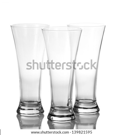 Three beer empty glasses isolated on white