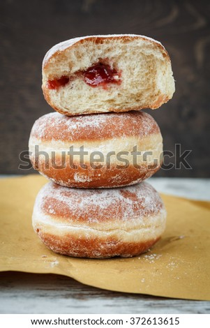 Three Berliner or krapfen - stock photo