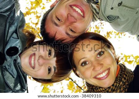 Three best friends in autumn park. - stock photo