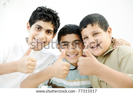 Three best friends together saying OK, thumbs up! - stock photo