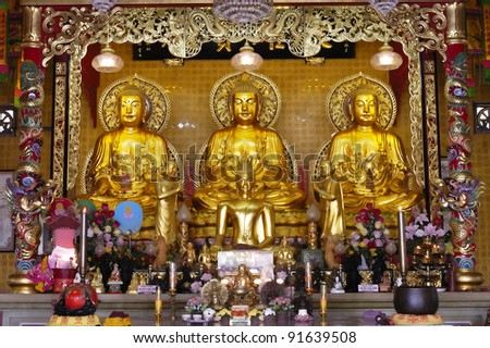 Three big golden buddha in chinese temple. In Thailand. - stock photo