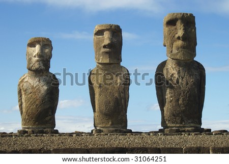 three big moais made of volcanic rock in easter island - stock photo