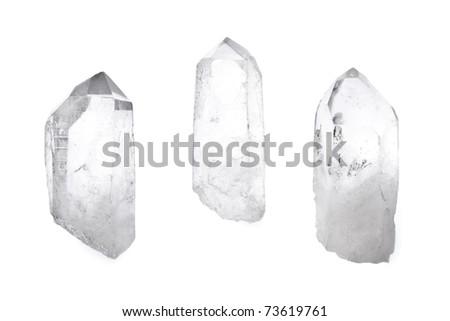 Three big natural quartz crystals isolated on white. - stock photo