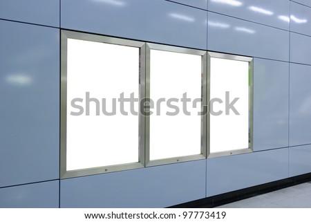 Three big vertical / portrait orientation blank billboard on modern blue wall - stock photo