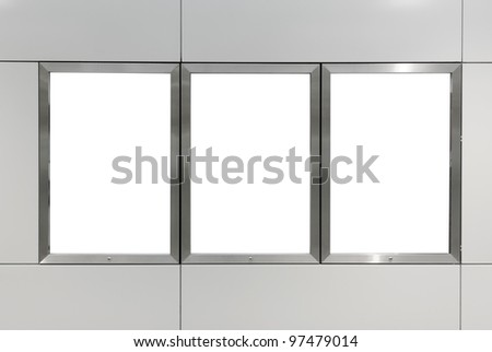 Three big vertical / portrait orientation blank billboard on modern gray wall - stock photo