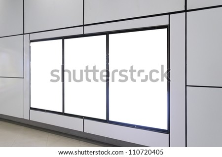 Three big vertical / portrait orientation blank billboard on modern white wall - stock photo