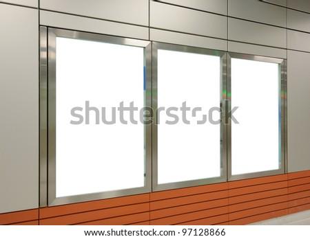 Three big vertical / portrait orientation blank billboard on modern white wall - stock photo
