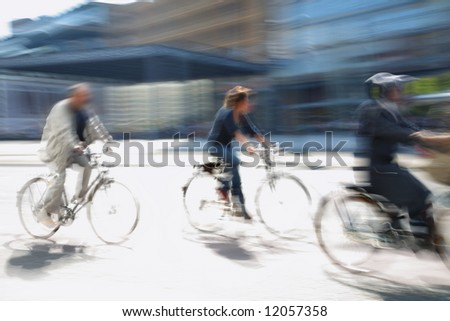 three biker drive in the modern city - stock photo