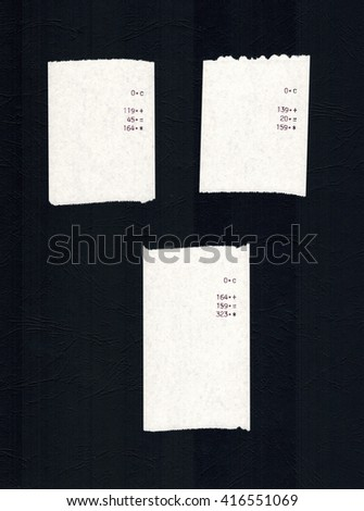 Three bills or receipts isolated over black background - stock photo