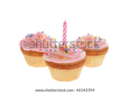 Three birthday cupcakes are isolated on white background.