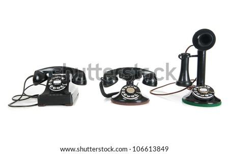 Three black antique phones on a white background - stock photo