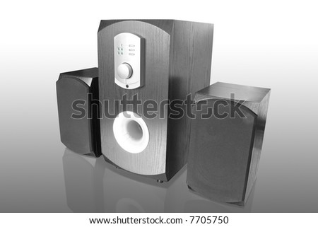 three black computer speakers with built in amplifier - stock photo