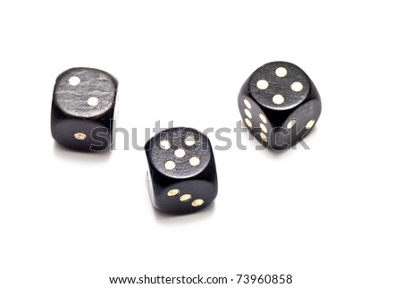 three black dices over a white background