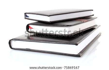 Three black notebooks on white background - stock photo