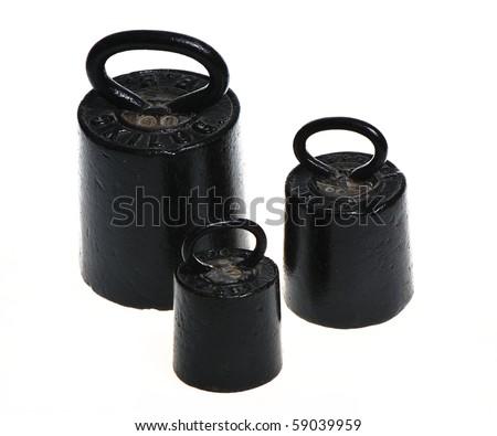 Three black weights - stock photo