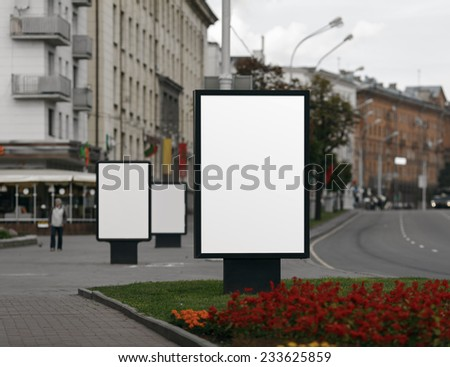 Three Blank Billboards on City Street. Shallow depth of field. Clipping path. - stock photo