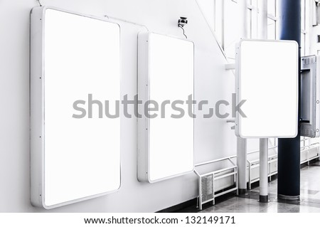 Three blank billboards situated at a generic city location that could be anywhere in the world. - stock photo