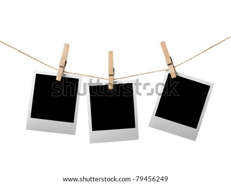 Three blank instant photos hanging on the clothesline. Isolated on white background. - stock photo