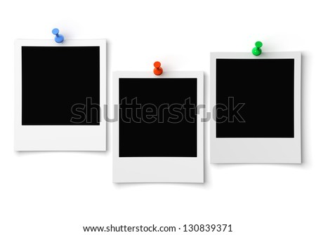 three blank photo pinned on wall - stock photo