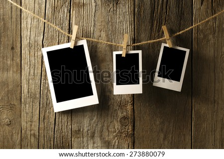 Three Blank photographs hanging on a clothesline - stock photo