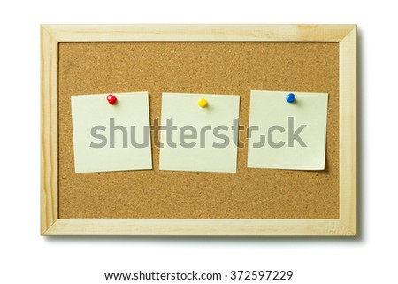 Three blank post it notes on a cork notice board - stock photo