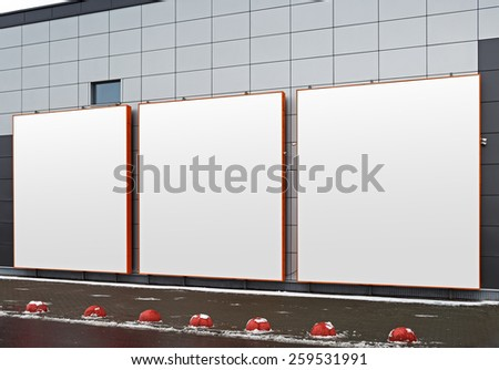 Three blank square advertising space on the facade of a modern building. Isolated on white with clipping path. - stock photo