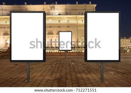 Three blank street billboards at night city. Isolated with clipping path around advertising display. 3d illustration.