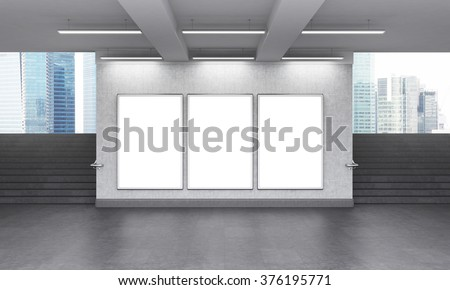 Three blank vertical billboard in the underground crossing, stairs up on both sides, Singapore seen from the street. Grey walls. Front view. Concept of underground advertising. 3D rendering