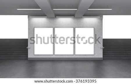 Three blank vertical billboard in the underground crossing, stairs up on both sides, white light seen from the street. Grey walls. Front view. Concept of underground advertising. 3D rendering